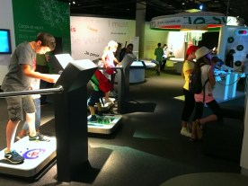 Children testing their balance and other skills at interactive play stations.