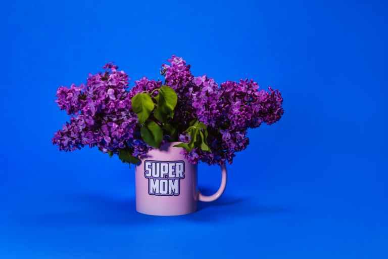 a pink mug with lilac flowers