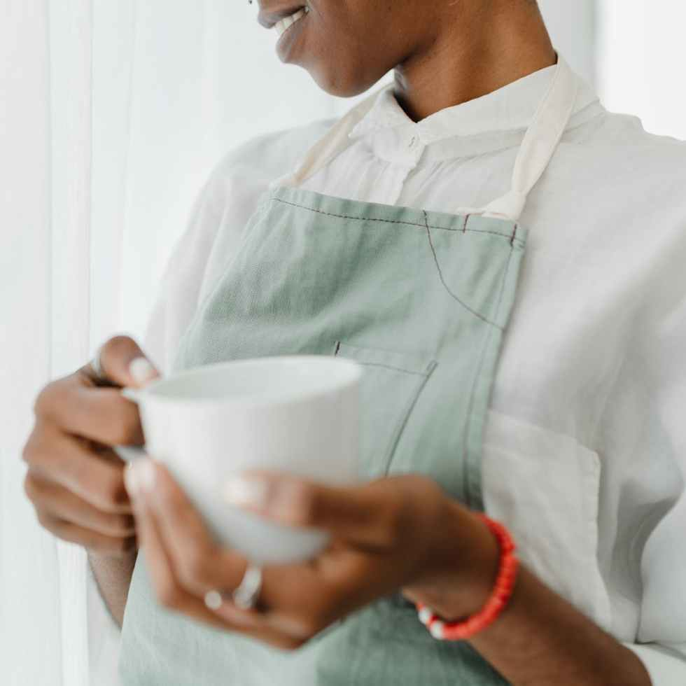 crop african american female bartender with coffee in coffee shop