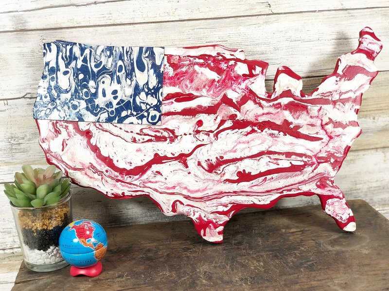 Learn how to create a Paint Pour American Flag with DecoArt on a USA wooden plaque a patriotic tutorial with Creatively Beth