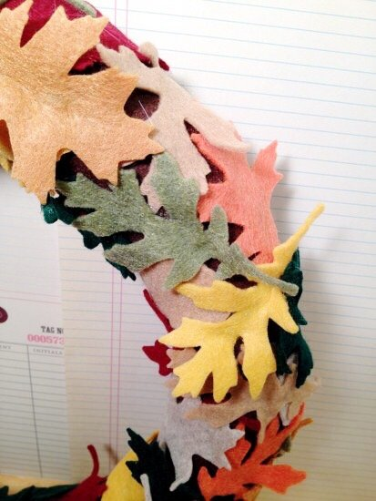 Creatively Beth contine to layer Kunin Felt leaves on wreath #creativelybeth #wreath #feltcrafts #autumnleaves #fallleaves #fallcrafts