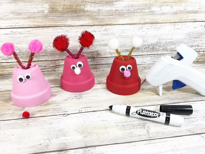 Add features Clay Pot Love Bugs Craft Creatively Beth #creativelybeth #dollartreecrafts #kidscrafts #claypotcrafts #valentinesdaycrafts