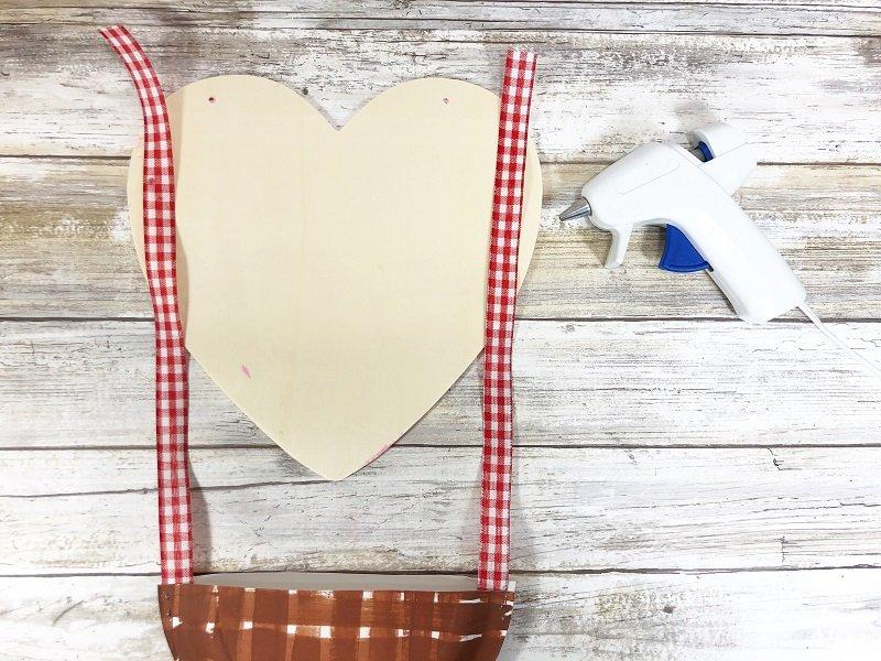 Attach ribbon to back of heart Hot Air Balloon Valentine Mailbox Creatively Beth #creativelybeth #dollartreecrafts #kidscrafts #valentinesdaycrafts