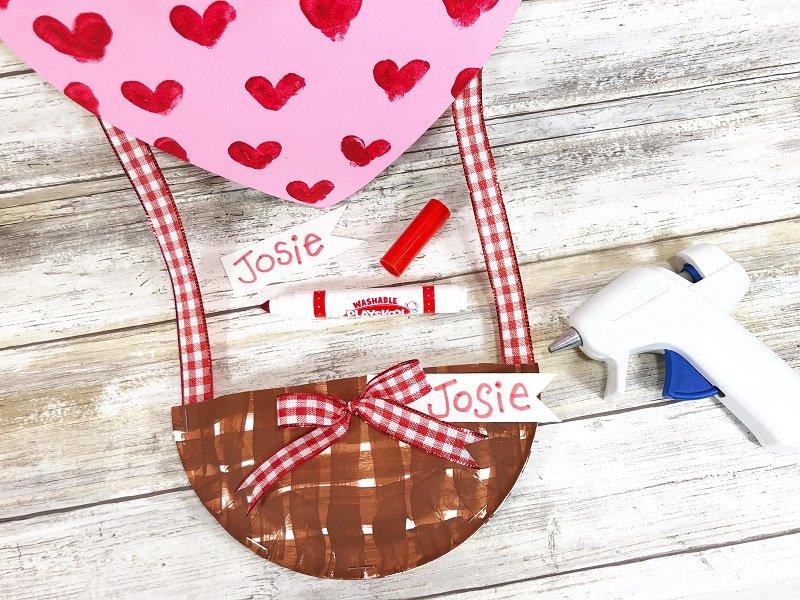 Add name tag Hot Air Balloon Valentine Mailbox Creatively Beth #creativelybeth #dollartreecrafts #kidscrafts #valentinesdaycrafts