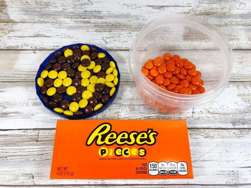 Orange Candy-Coated Peanut Butter Candies are the secret Creatively Beth #creativelybeth #masonjarcrafts #leprechaun #stpatricksday #kidscrafts