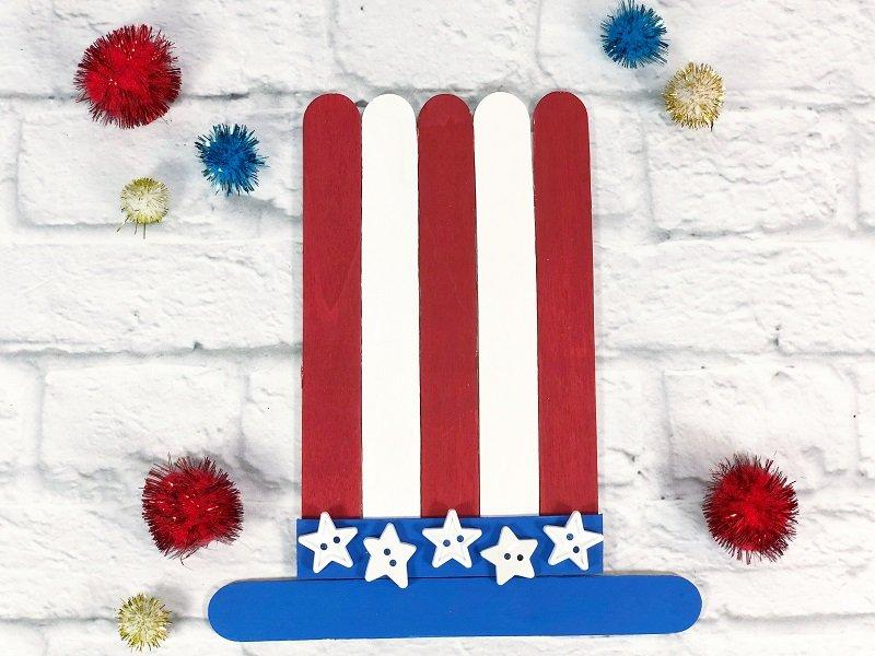 Uncle Sam Hat DIY with craft sticks from Dollar Tree Creatively Beth #creativelybeth #craftsticks #kidscrafts #patrioticcrafts #redwhiteandblue