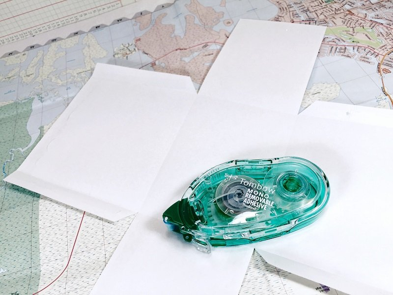 Attach pattern to map with Tombow MONO Removeable Adhesive Creatively Beth #creativelybeth #upcycled #recycled #crafts #maps