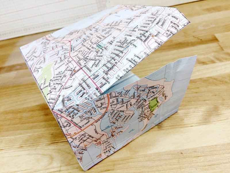 Build gift bag by attaching tabs to base with Tombow Xtreme Adhesive Creatively Beth #creativelybeth #upcycled #recycled #crafts #maps