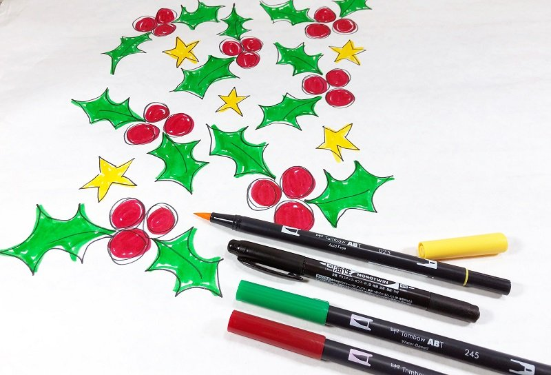 Draw holly berries, holly leaves and stars with Tombow Dual Brush Pens then outline with MONOTWIN Permanent Marker Creatively Beth #creativelybeth #christmas #wrappingpaper #tombowdualbrushpens #doodle #plaid #handlettering