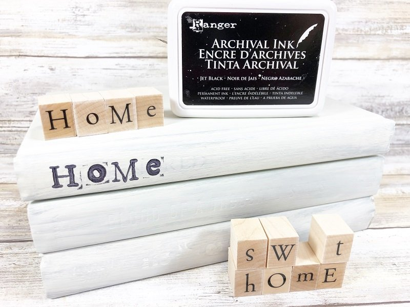 I love the righ nature of over stamping the letters to give a rustic look Creatively Beth #creativelybeth #dollartreecraft #homedecor #bookstack #diy
