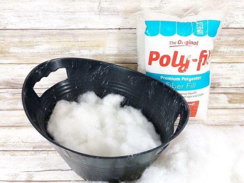 Fill bottom half of plastic tub with Poly-Fil from Fairfield World Creatively Beth #creativelybeth #polyfil #ffw80 #dollartreecrafts #halloweencrafts