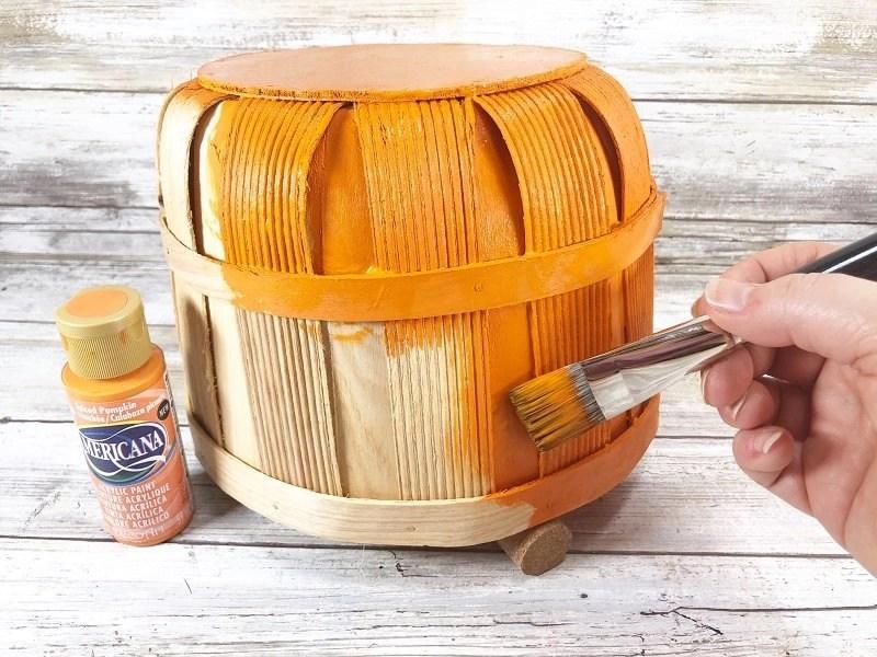 Basecoat the basket with spiced pumpkin acrylic paint Creatively Beth #creativelybeth #dollartree #craft #falldecor #bushelbasket #pumpkin #craft