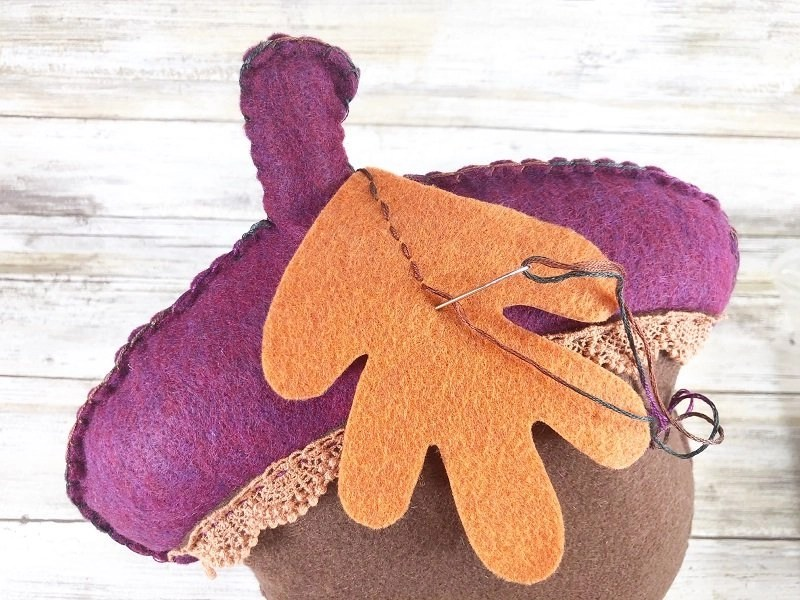 Stitch veins onto the felt leaf with embroidery floss and needle by Creatively Beth #creativelybeth #polyfil #fairfieldworld #autumnhomedecor #easysewingproject