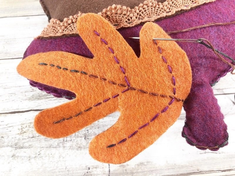 Sew leaf onto the top of the Acorn Pillow to finish by Creatively Beth #creativelybeth #polyfil #fairfieldworld #autumnhomedecor #easysewingproject