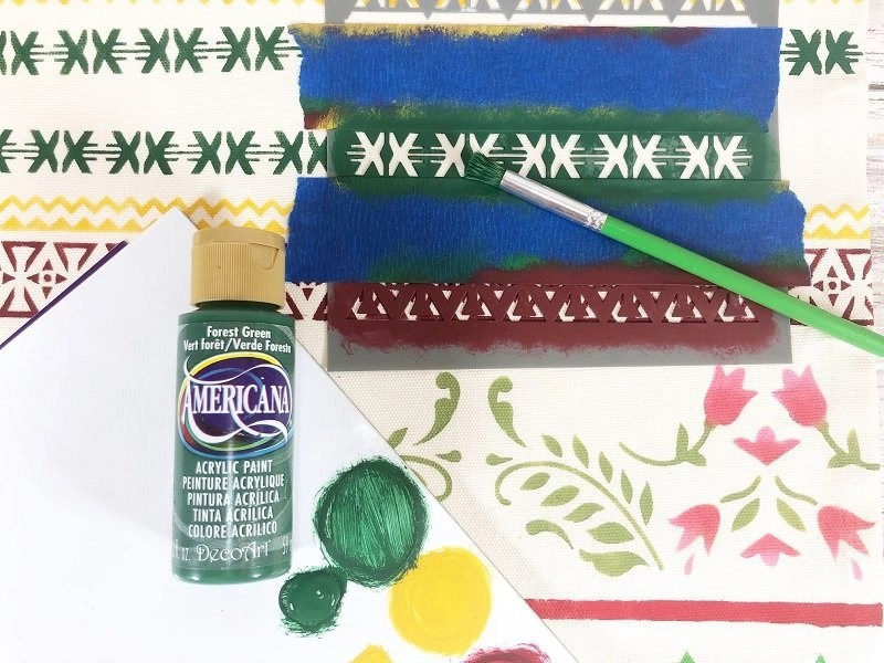 Add additional stenciled designs with a variety of holiday colors Creatively Beth #creativelybeth #fairfieldworls #uglychristmassweater #pillowparty2020 #stenciled #decoart