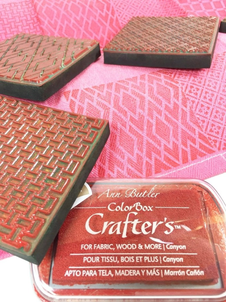 Stamp faux quilted designs on the ombre kitchen towels Hugs and Kisses Kitchen Towels for Valentine's Day Creatively Beth #creativelybeth #valentinesday #crafts #hugsandkisses