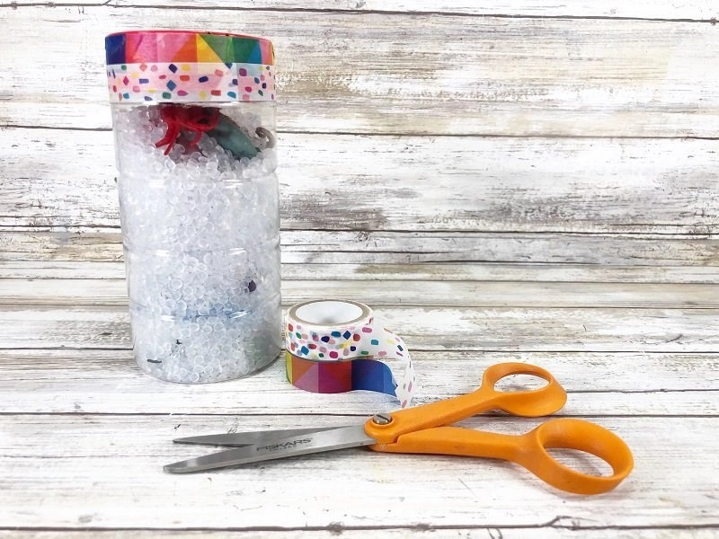Add decorative tape around the lid of the bottle by Creatively Beth #creativelybeth #sensorybottle #freeprintable #wordsearch #doodles #madewithFFW