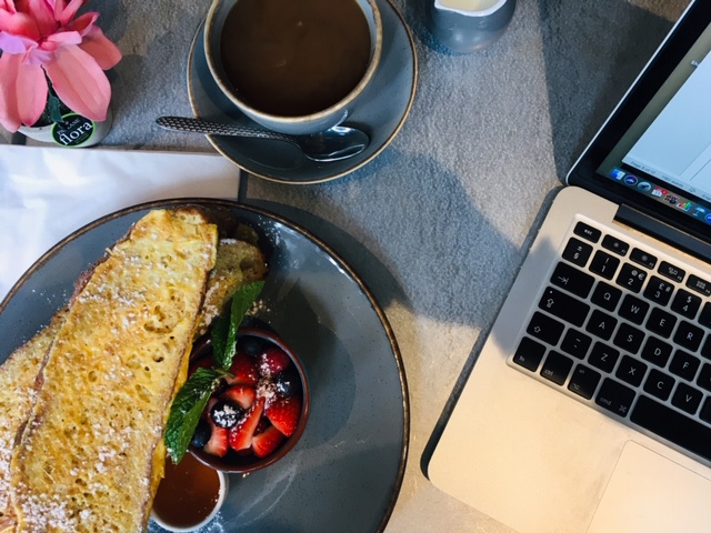 laptop and coffee and french toast