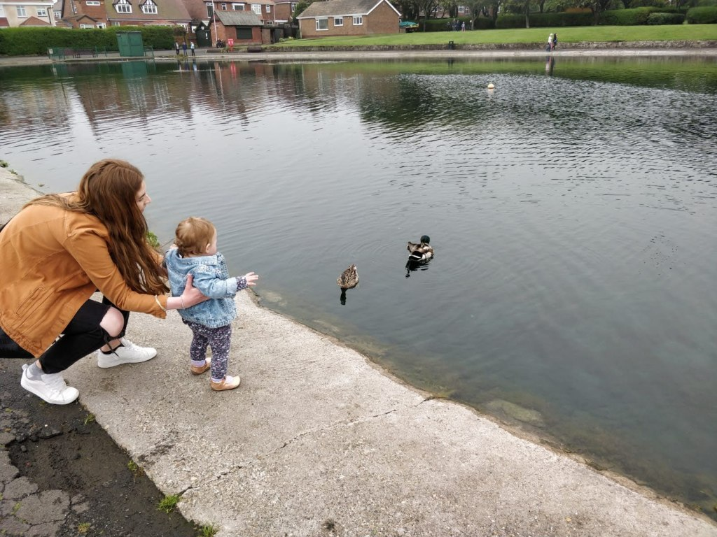 Danielle Slade with her daughter at a local duck pond