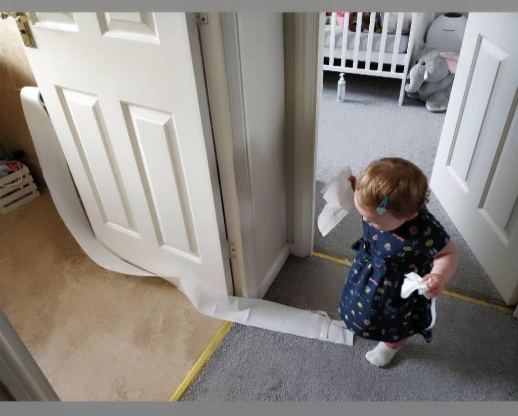 Toddler with toilet roll - Moments in the Mundane