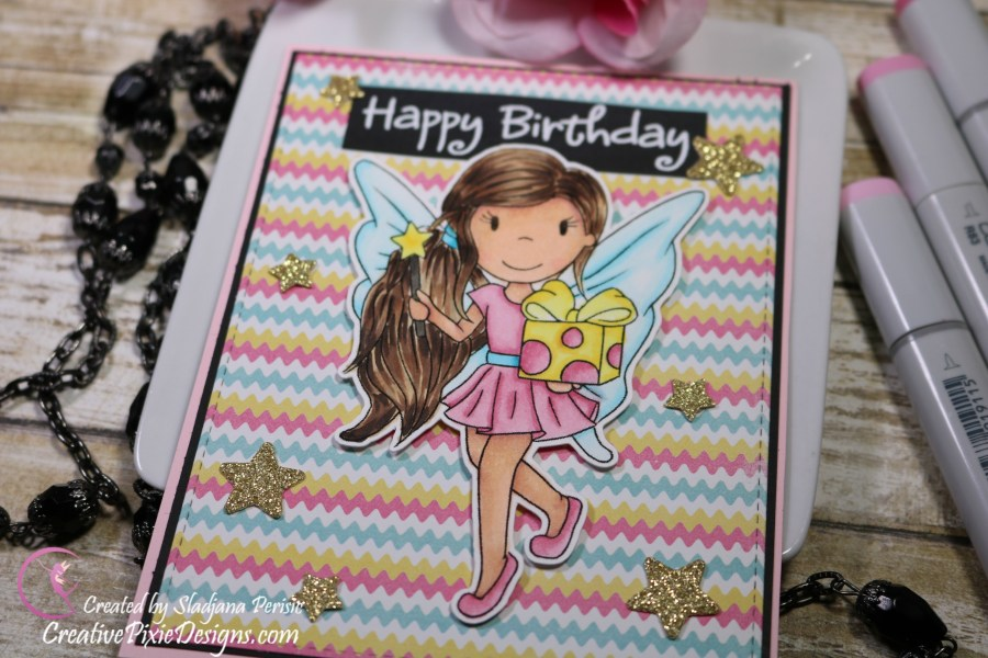 The Paper Nest Dolls Fairy Avery with a gift digital stamp colored with Copic Markers and patterned paper background handmade birthday card.