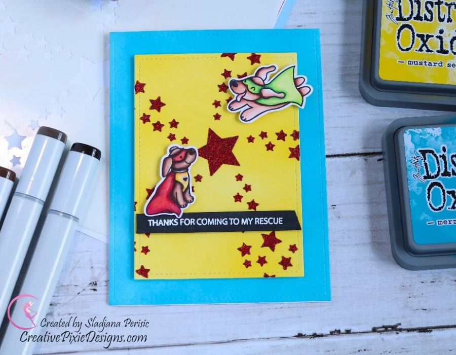 Heffy Doodle Rescue Dogs clear stamp colored with Copic markers and set on an ink blended background. Heffy Doodle Star Swirl Stencil created with Nuvo Glitter Paste in Garnet Red. Handmade card.