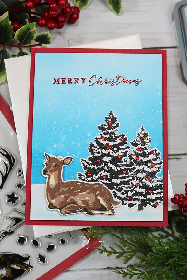 Hero Arts Color Layering Deer stamp combined with Hero Arts Color Layering Christmas Tree stamp images set against and ink blended background to create a beautiful Merry Christmas handmade card.