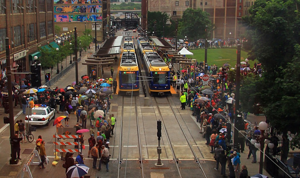 Opening day on the Green Line. Flickr photo by Michael Hicks. https://www.flickr.com/photos/mulad/14238058898/
