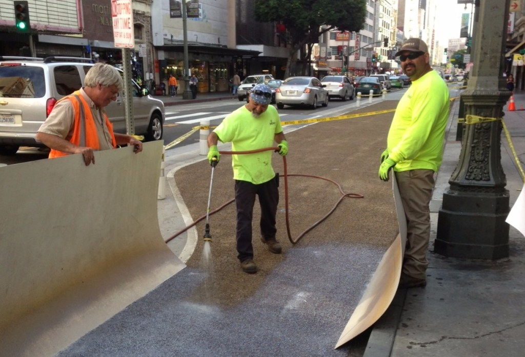 Photos courtesy of Joe Linton, Streetsblog LA. http://la.streetsblog.org/2015/07/09/broadway-dress-rehearsal-project-gets-new-more-durable-surface/