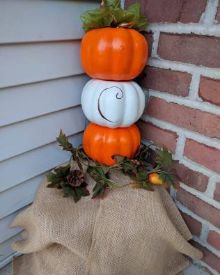 This was my favorite one to make with our last name letter. Super simple, cost $5 and 5 minutes to make (minus drying time for the white pumpkin).