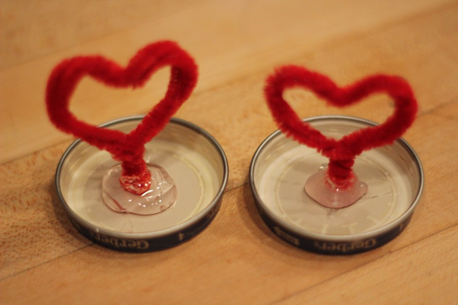 Let the hearts dry standing in the hot glue.