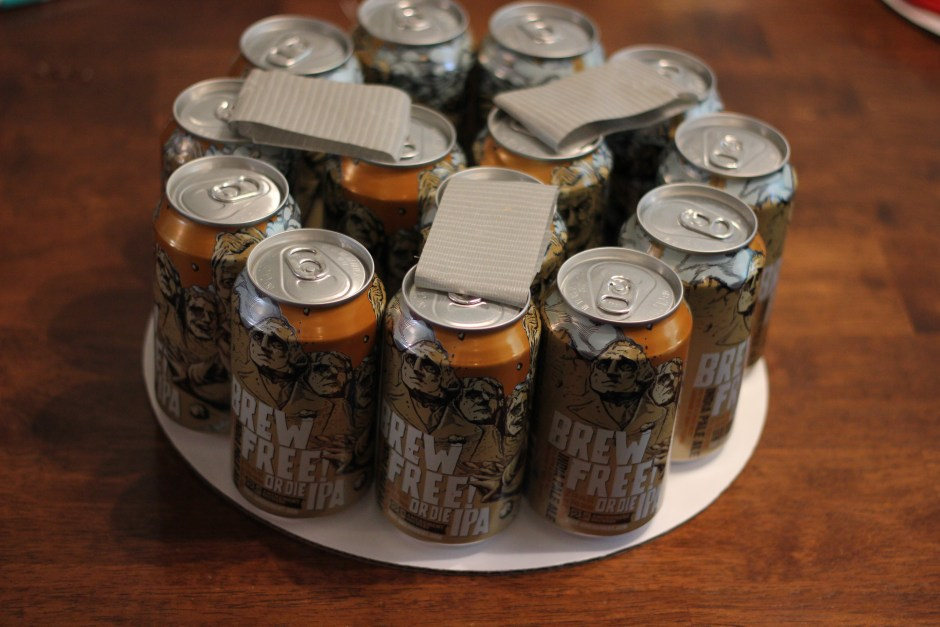 Duct tape on top of beers to attach to 2nd layer.
