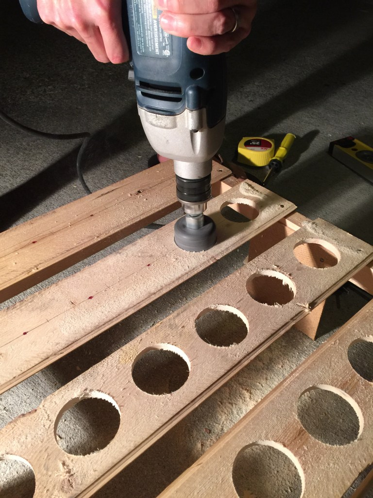 Drilling holes with a door knob bit.