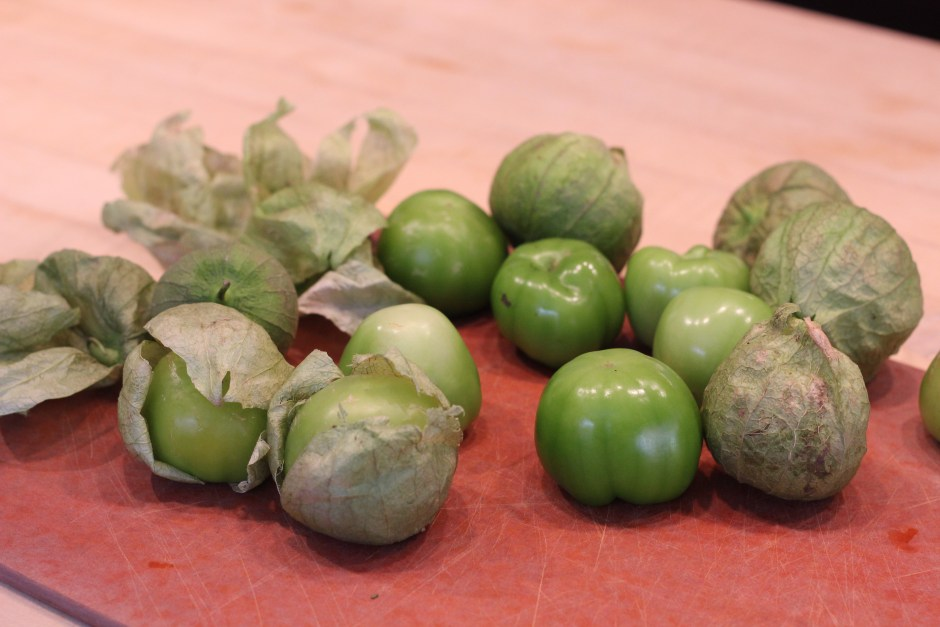 Clean the tomatillos by taking the husk off and rinsing.