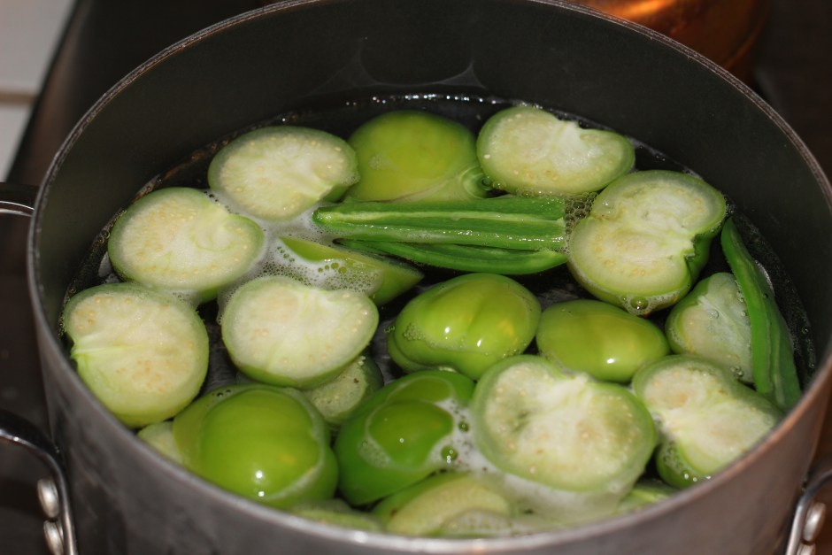Boil the tomatillos and seeded jalapeño peppers.