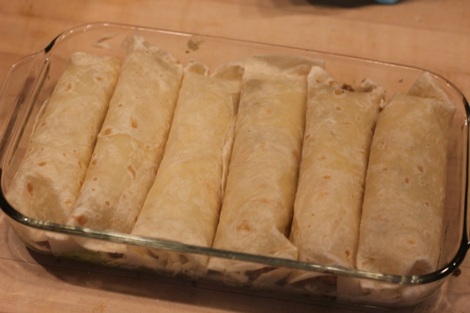 Roll tortillas and put them seam side down and close together.