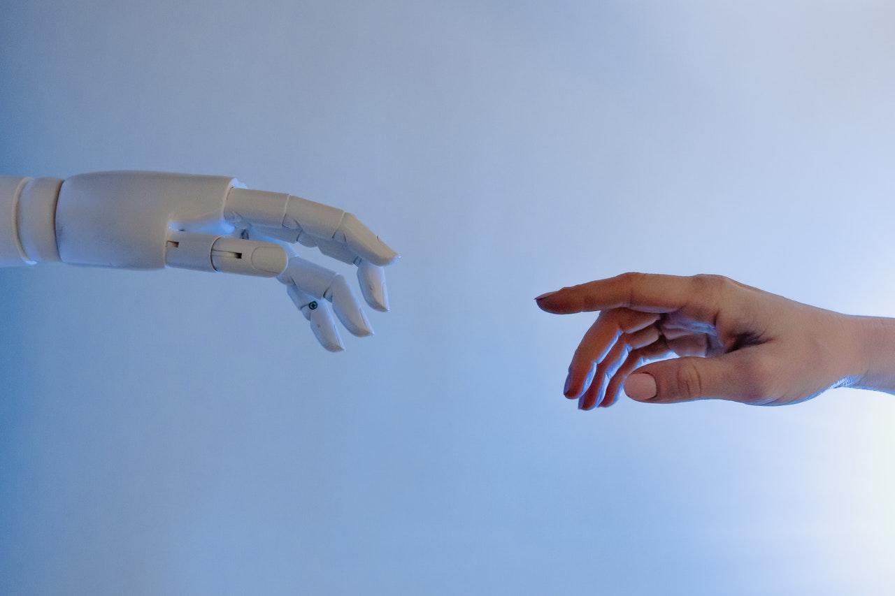 robot hand reaching for human hand