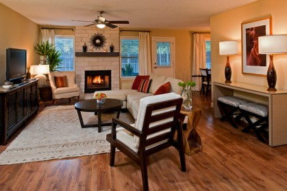 The stone fireplace creates a focal point. The TV is a secondary focal point