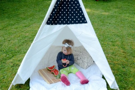 Kids outdoor picnic with watermelon and a tee pee