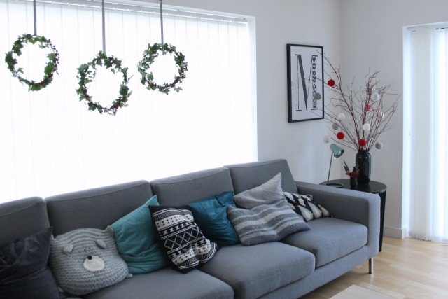 living room decor | Three hanging wreaths #happyholidays