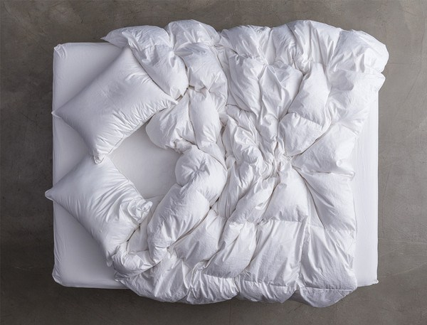 cozy white bed with white duvet