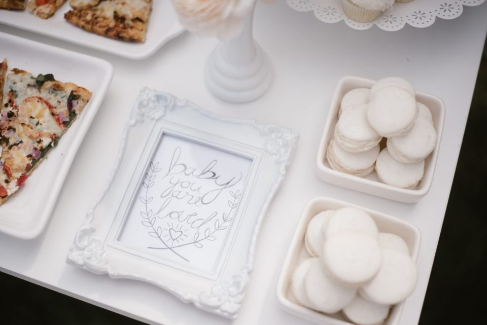 White macarons at white themed baby shower