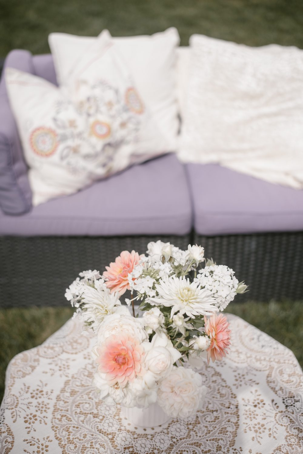 Outdoor white lace and floral boho meet the baby shower | White Boho Baby Shower
