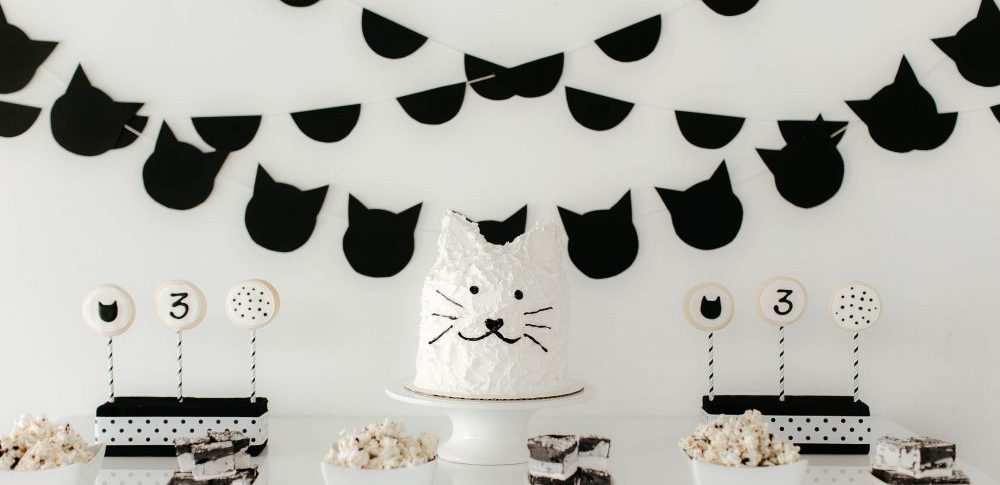 Black and White Cat Cake on a Dessert Table