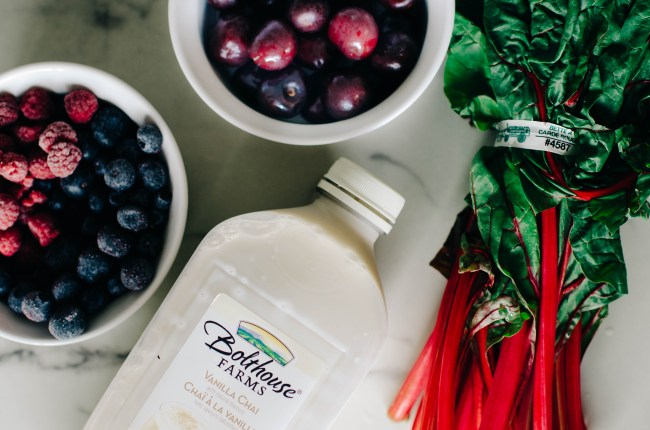 Ingredients to make a berry and greens vegan smoothie recipe using bolthouse diary free milk