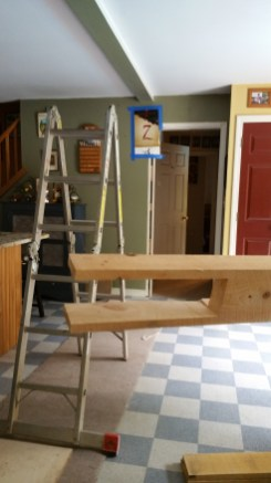 bringing-timber-beam-into-the-house (1)