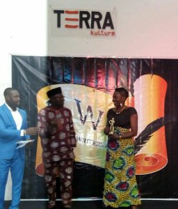 Performance Poet, Iquo Diana Eke, receiving the award on my behalf