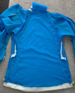 upcycled jacket pinned to the shape of the bag it will become