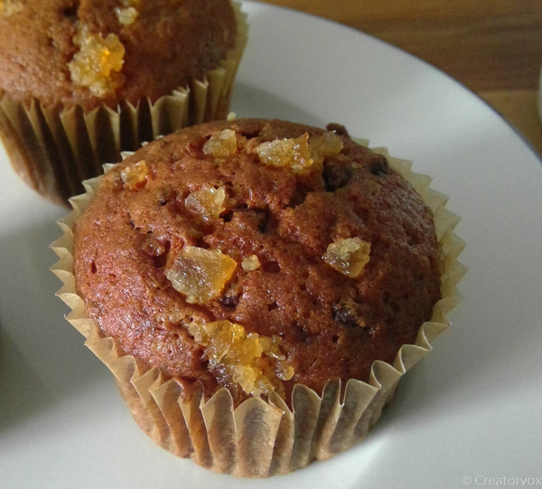 pumpkin chocolate chip muffins with crystallized ginger topping