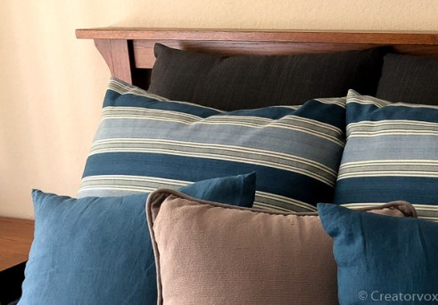 decorative pillow covers of various sizes on a bed